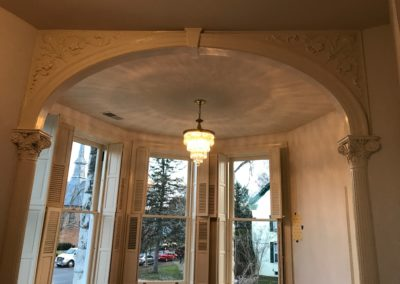 classical columns, composite columns, decorative columns, restoration, preservation, white columns, white louvered shutters, victorian shutters, arched entry way, millwork