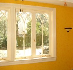 cathedral window, yellow walls, custom wood window
