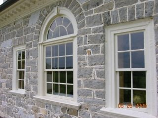 stone house, curved window, wood window, custom window
