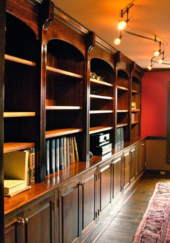 built in bookshelves, walnut shelves, red wall,