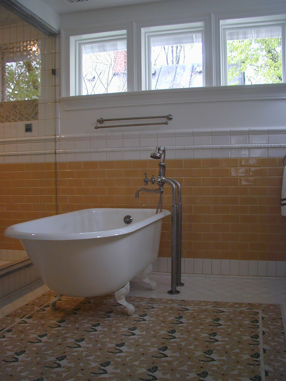 bathroom renovation, custom tile, yellow tile, flower tile, mosaic tile, colorful tile, custom windows, window repair, custom vanity, custom cabinetry, stone countertops, clawfoot bathtub, old fashioned bathtub, vintage bathtub, romantic bathroom, victorian bathtub,